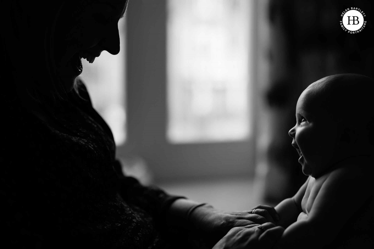 mother and baby portrait with very graphic light. Shot in black and white