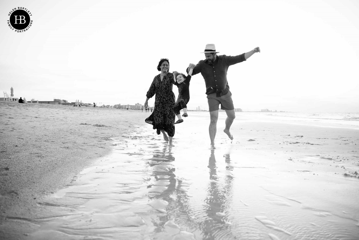 parents-swing-toddler-on-beach-family-photograph