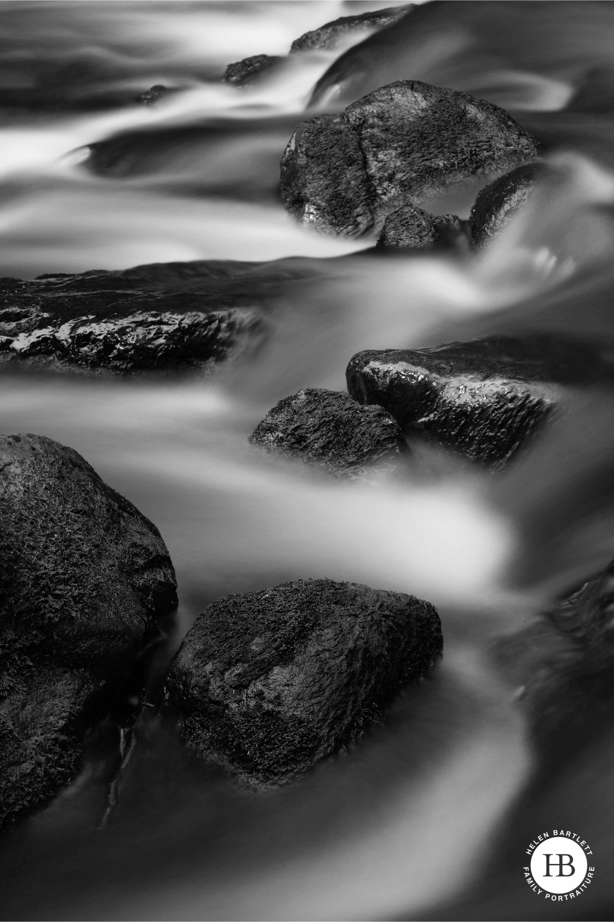 Slow shutter speed stream photo in black and white taken with a Canon tilt-shift lens.