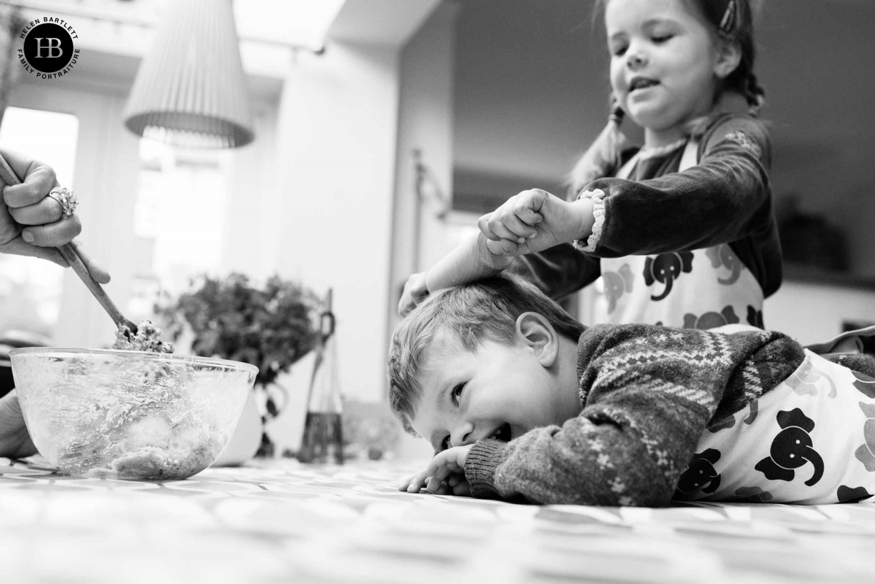 Two young children bake biscuits and play. Indoor photo shoots are fantastic to capture memories of things children do at home every day