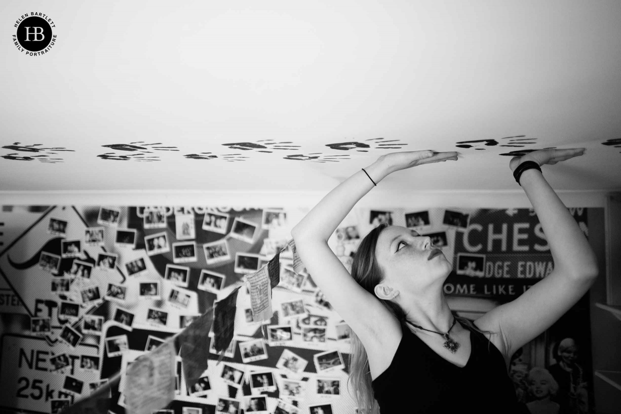 Teenage girl decorates her bedroom ceiling with hand prints