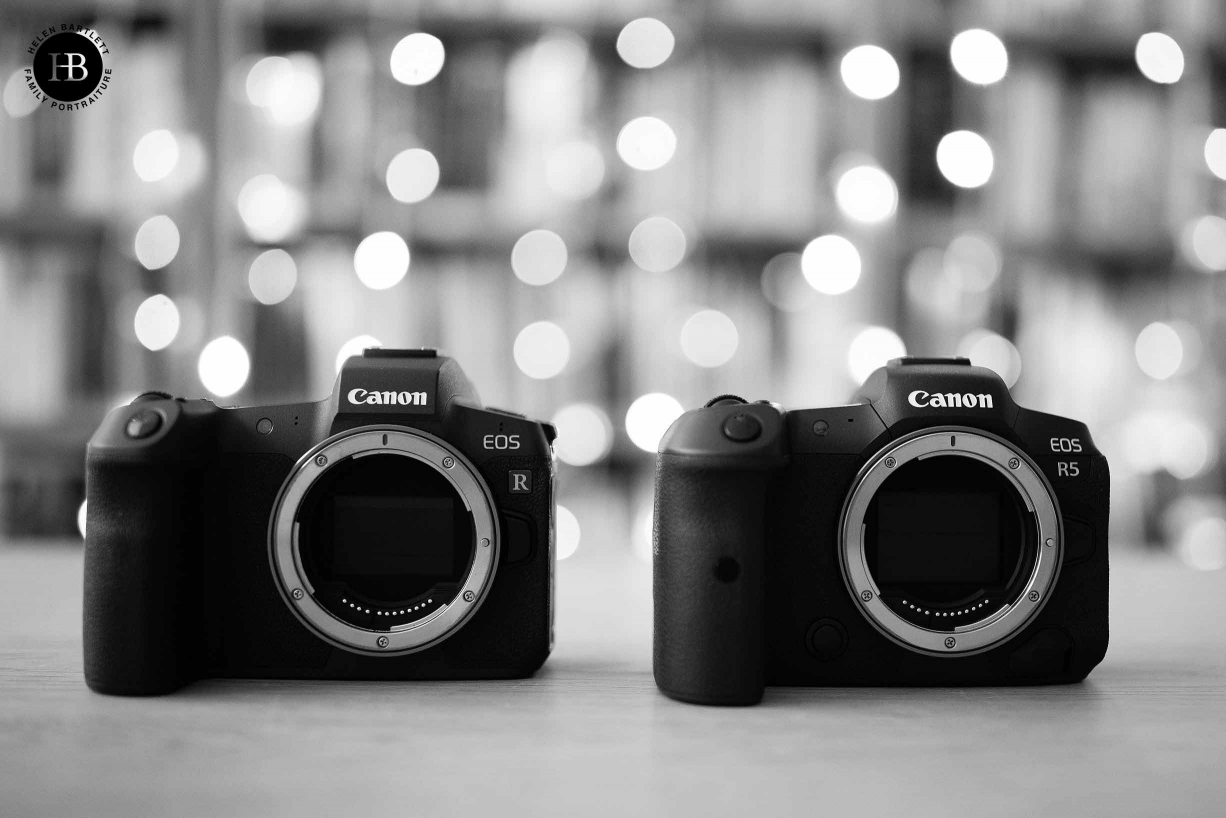 Comparison picture of Canon EOS R and Canon EOS R5 shot next to each other. Neither camera has a lens on the front showing the 12 pin mount of the R system.