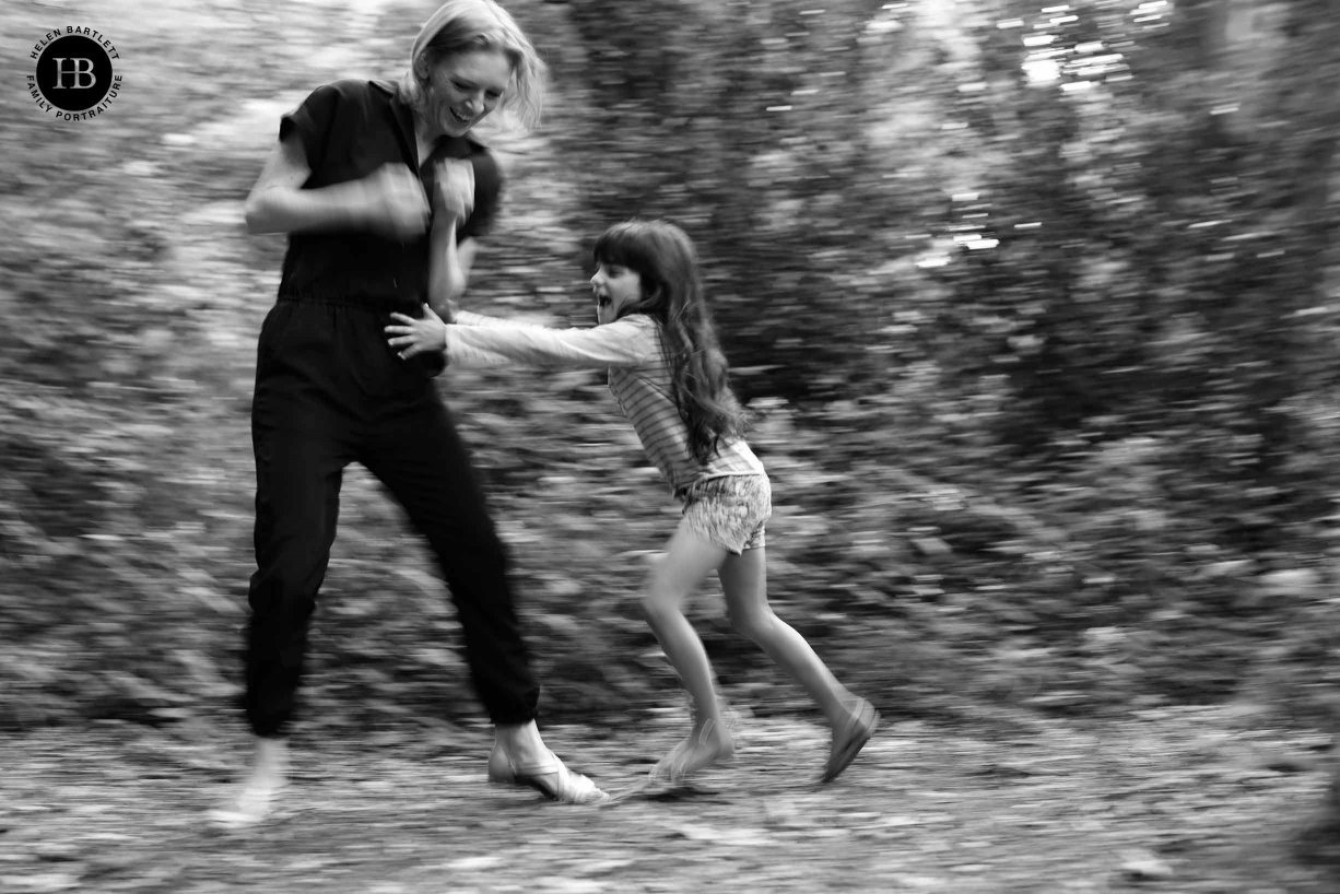 Little girl chases mother shot with 1/30 slow shutter speed panning. This image with the one above show how the new in body image stabilisation will give new creative possibilities.