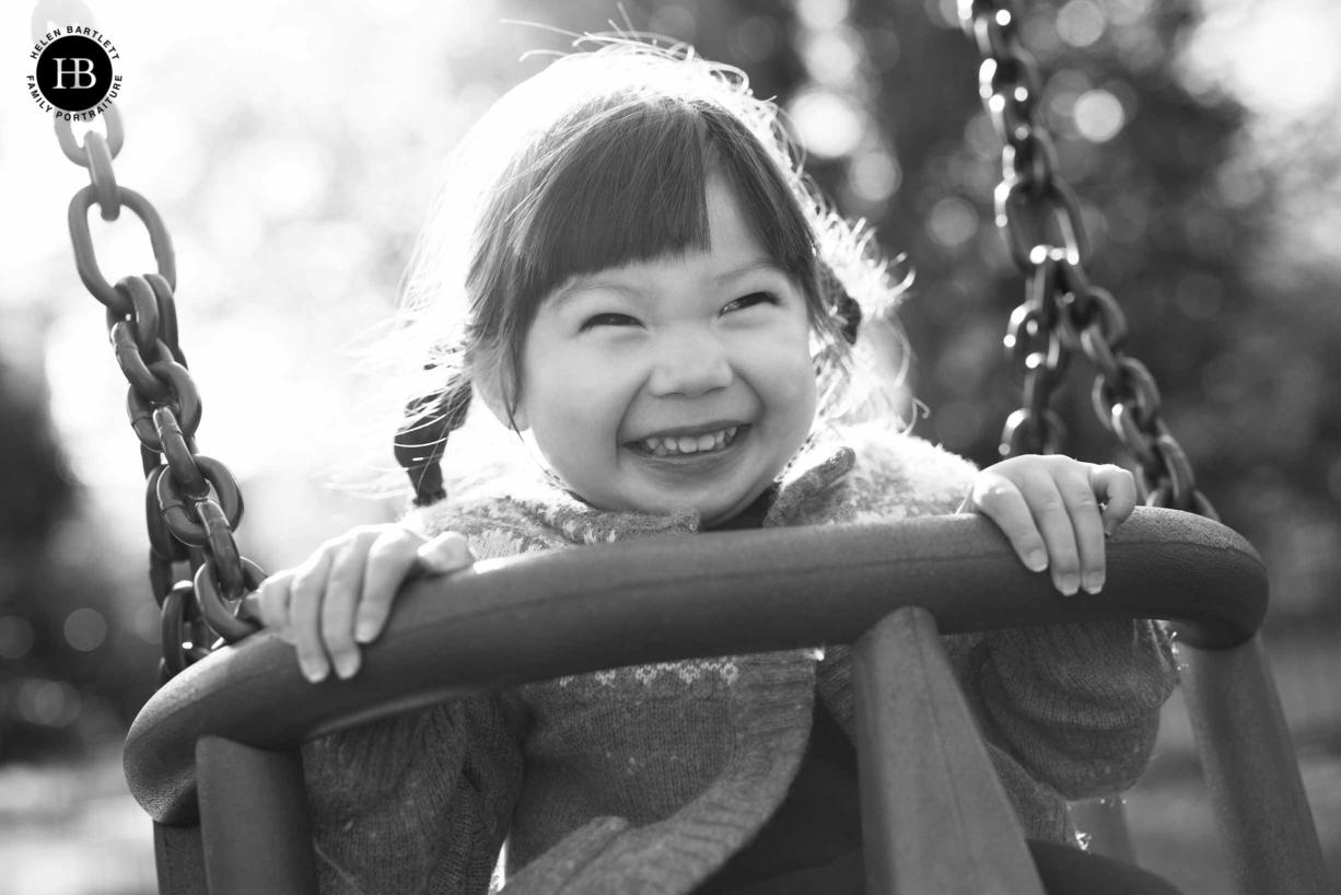 happy child on swings in hampstead