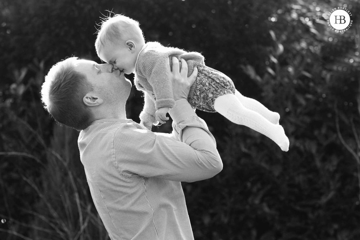 dad-kisses-baby-daughter