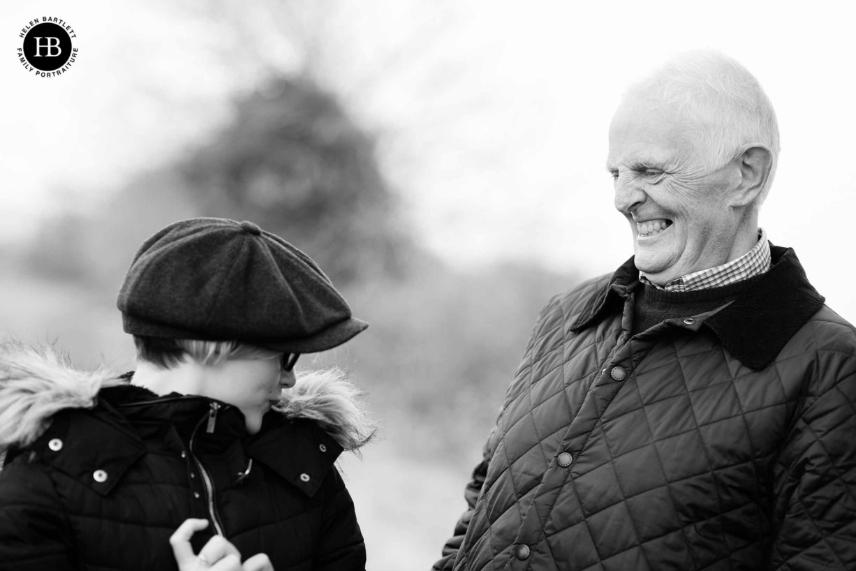 grandfather-laughs-with-teenage-granddaughter