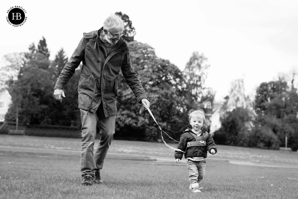 grandfather-plays-park-with-grandson