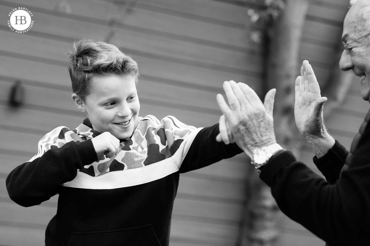 grandfather-teaches-grandson-to-box