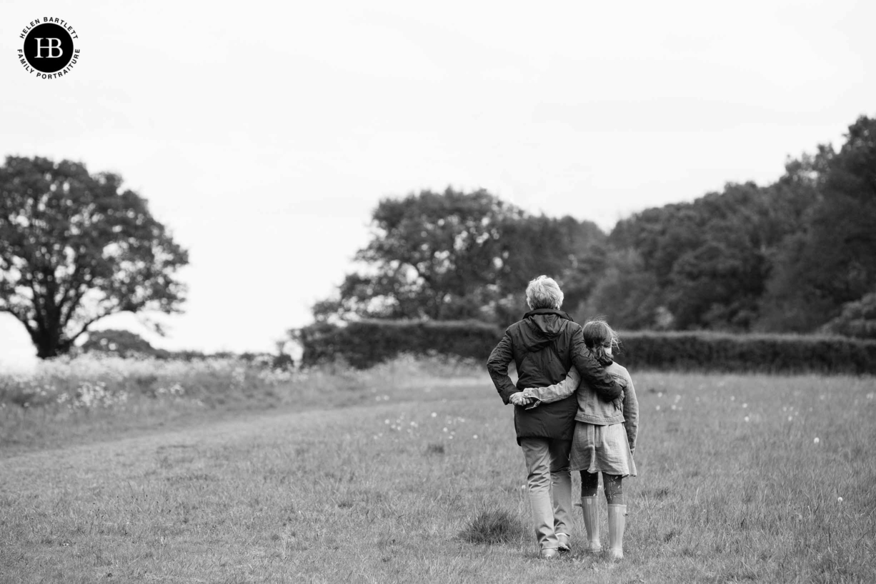 grandmother-and-granddaughter-walk-with-arms-around-each-other