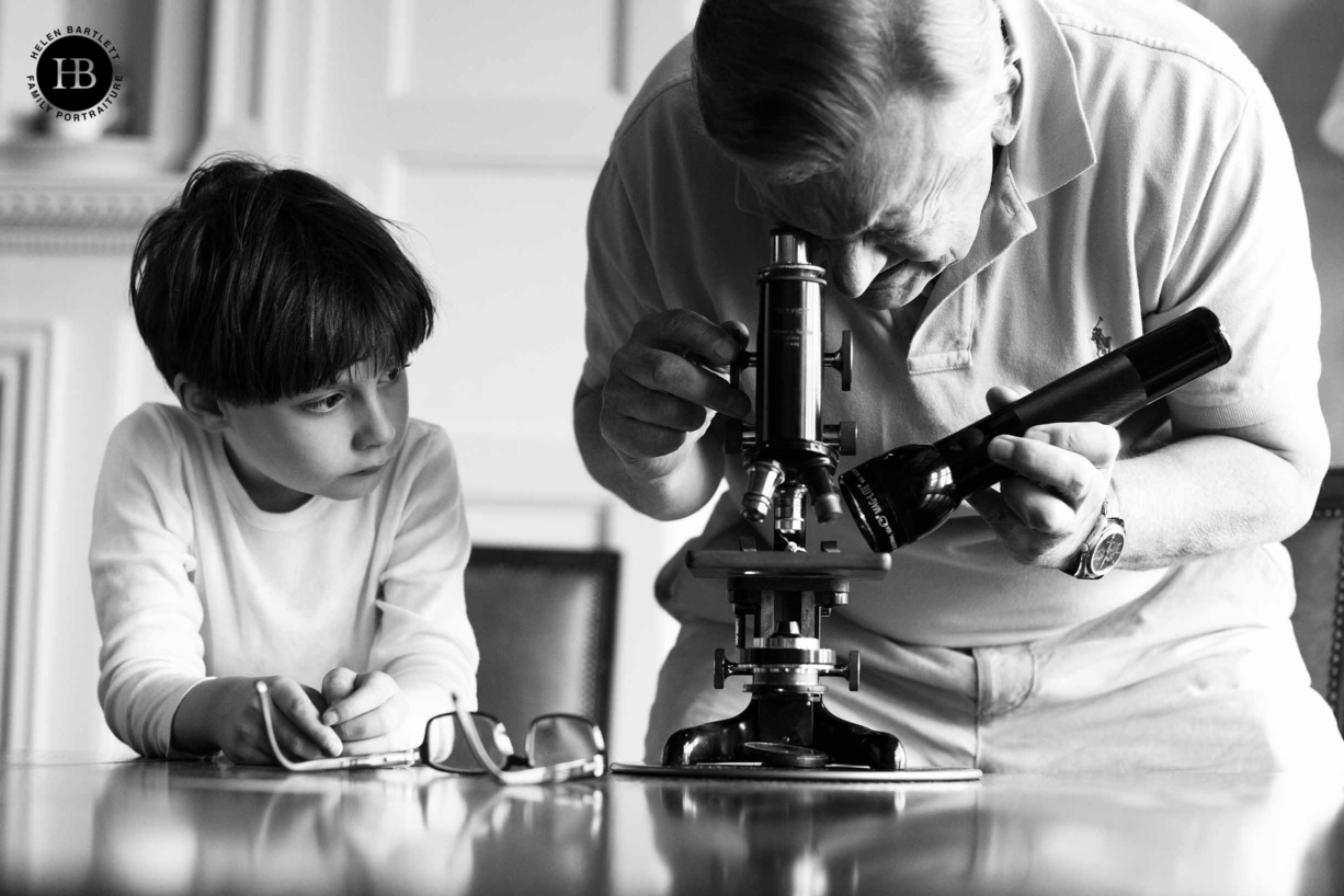 little-boy-taught-science-by-grandfather-on-family-photo-shoot-with-grandparents