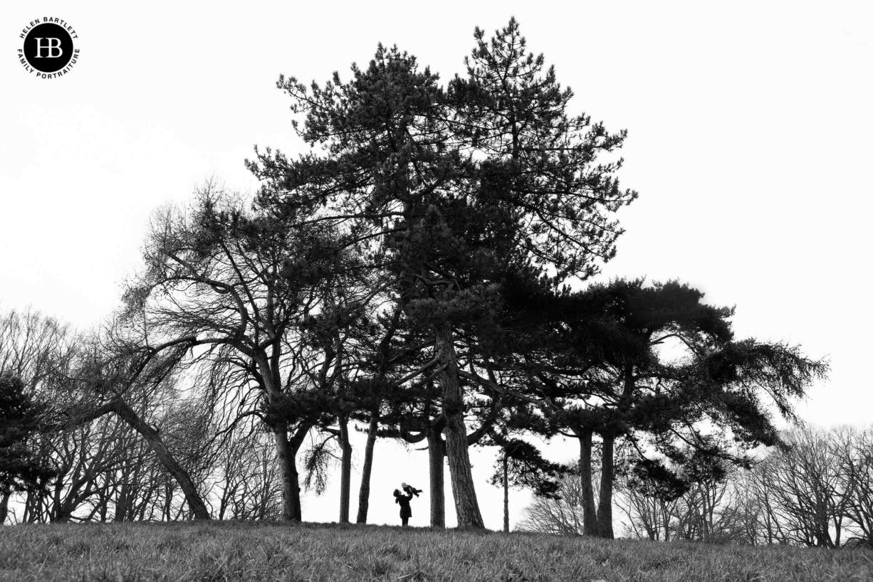 silhouette-mum-hold-baby-trees
