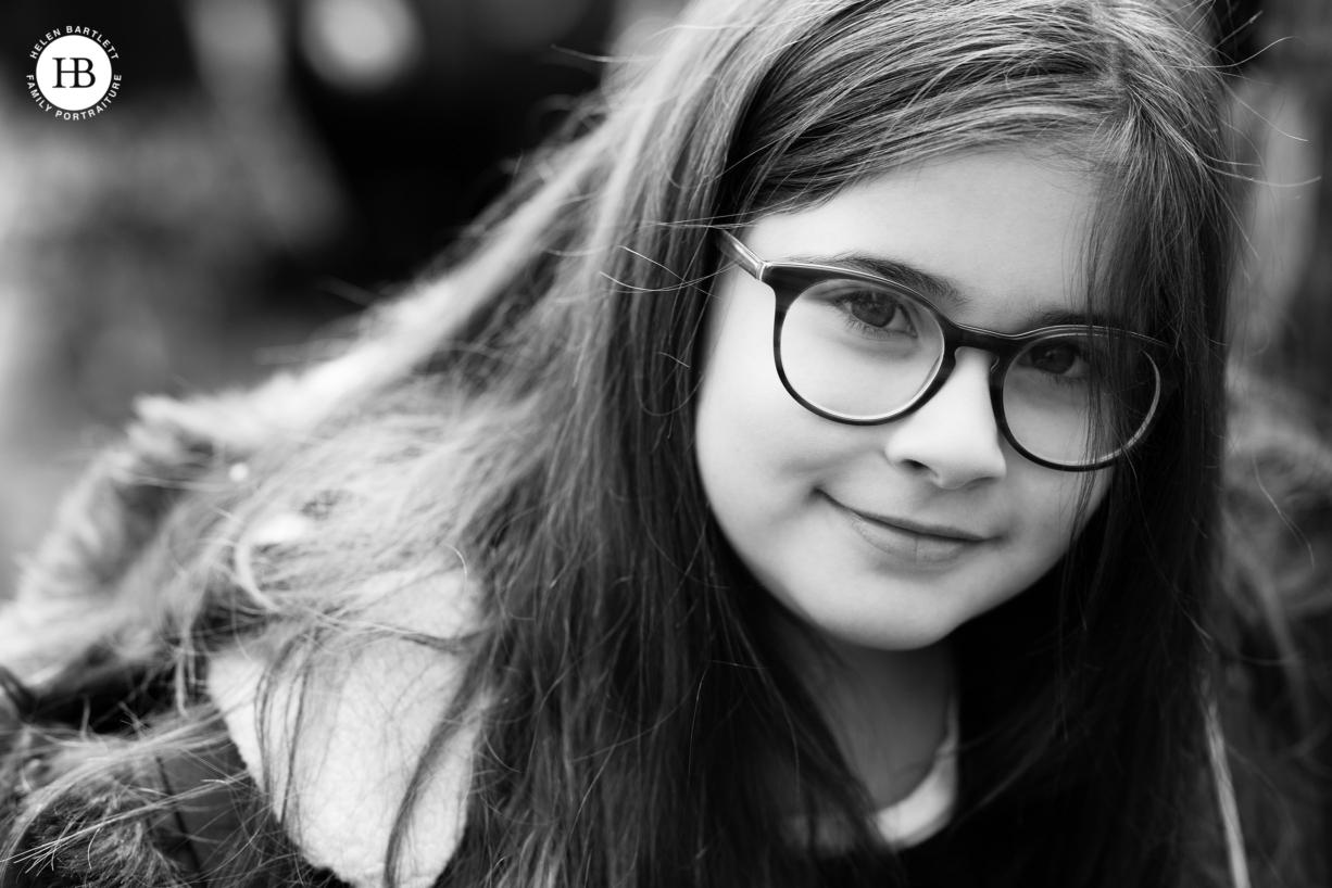 portrait of little girl wearing glasses