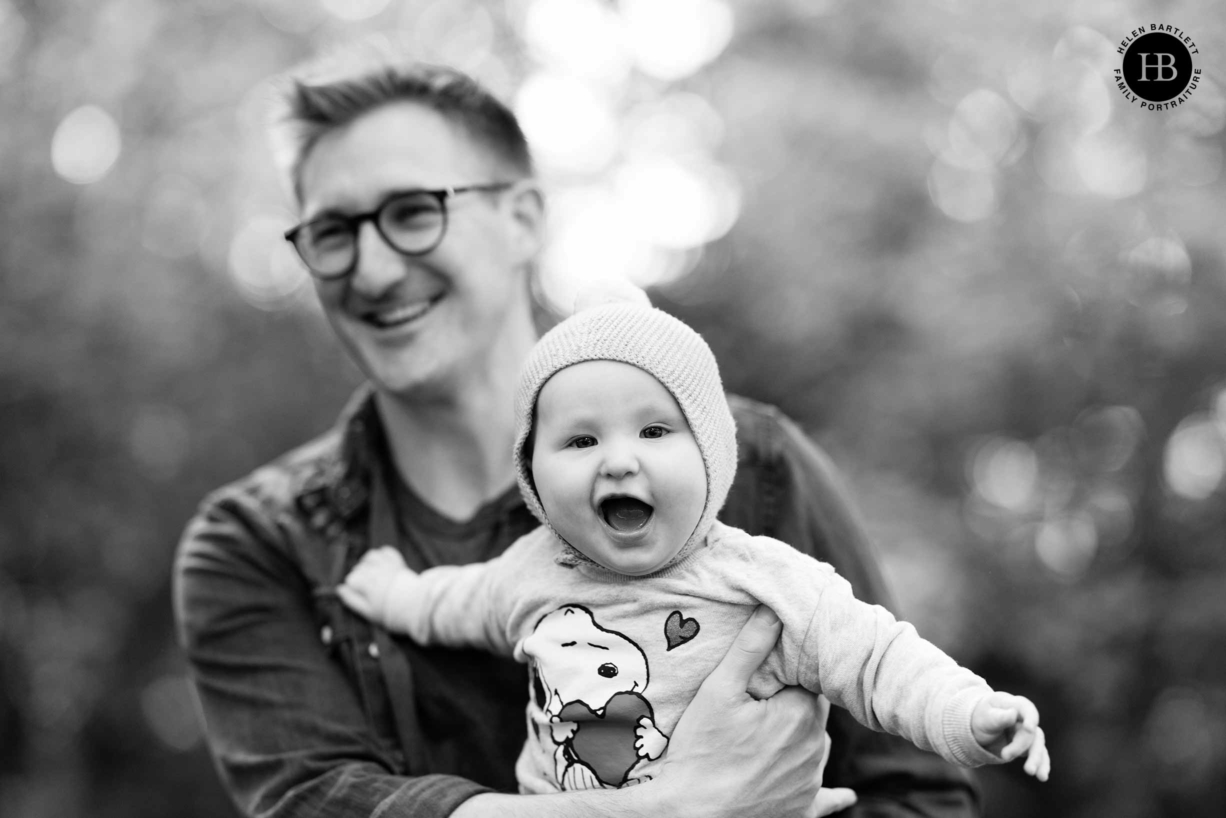 dad-holds-laughing-baby-during-professional-photo-shoot-islington