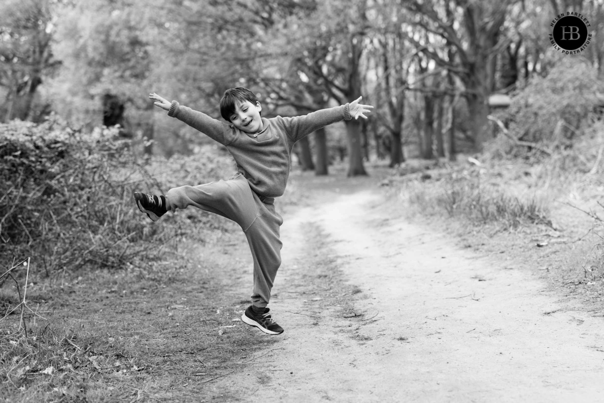 boy-jumps-in-air-during-a-game-in-richmond-park