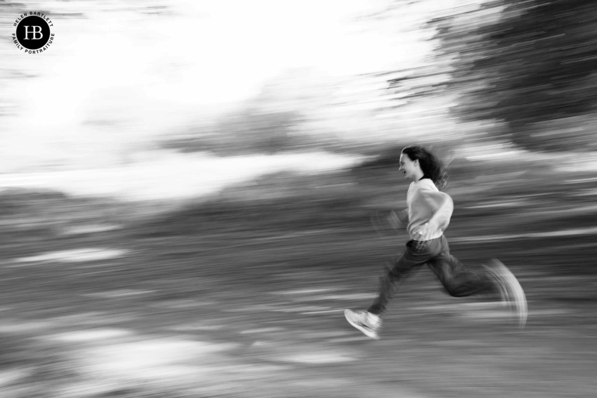 girl-running-in-richmond-park-photographed-using-panning-techinque
