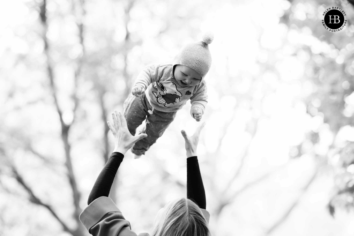 image-by-baby-photographer-in-islington-baby-laughing-while-thrown-in-air