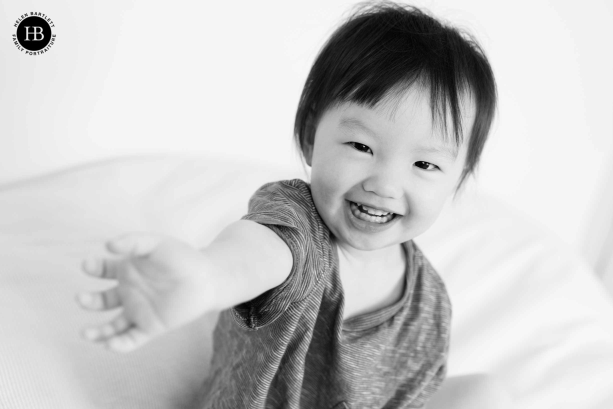 baby-plays-on-bed-during-blackheath-family-photography-session