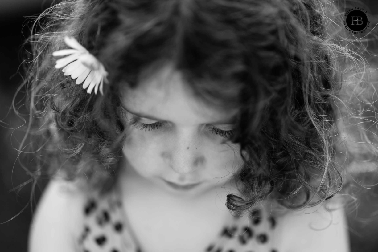 portrait of a young girl shot from above to show eyelashes with a shallow depth of field, victoria park in east london