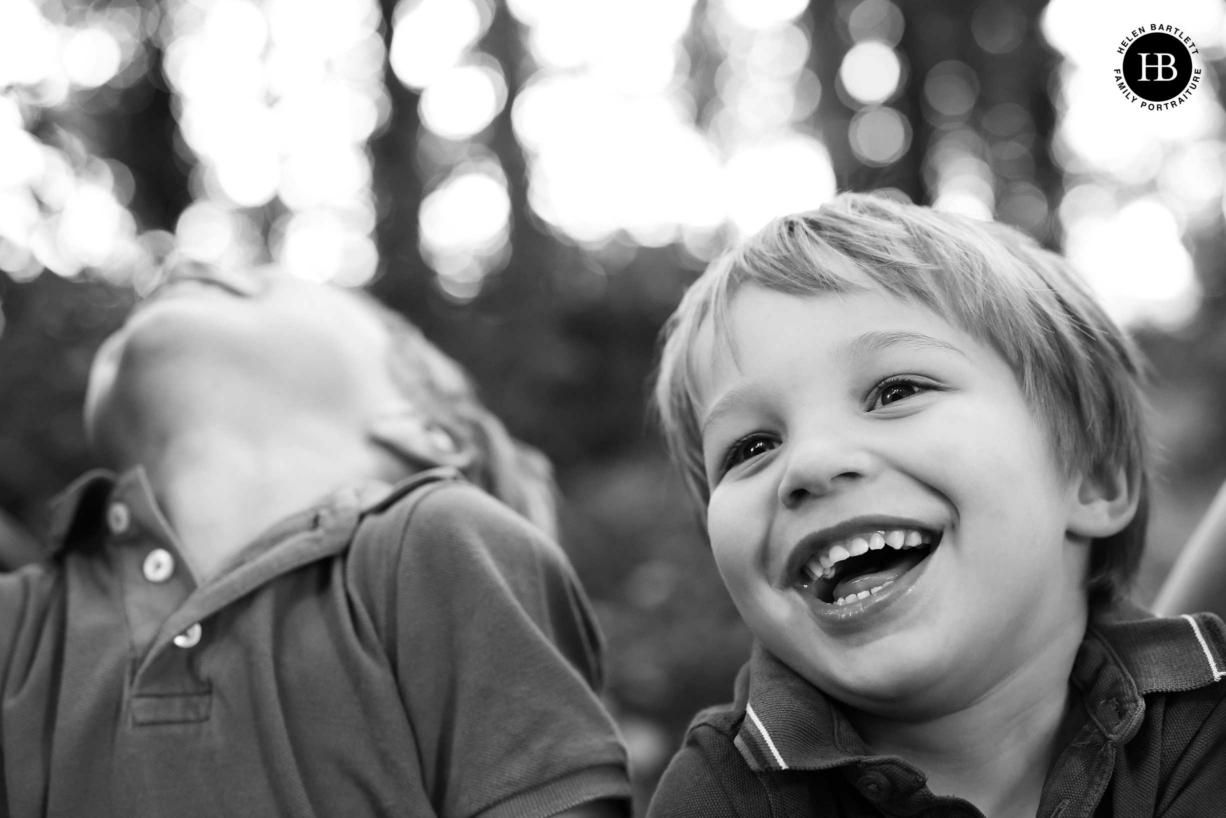 children-laughing-portrait-canon-camera