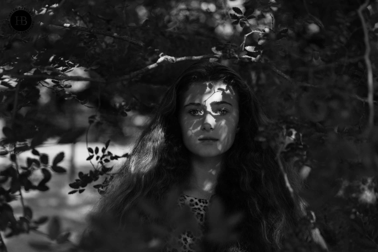 portrait of teenage girl with shadows of tree on her face, very beautiful