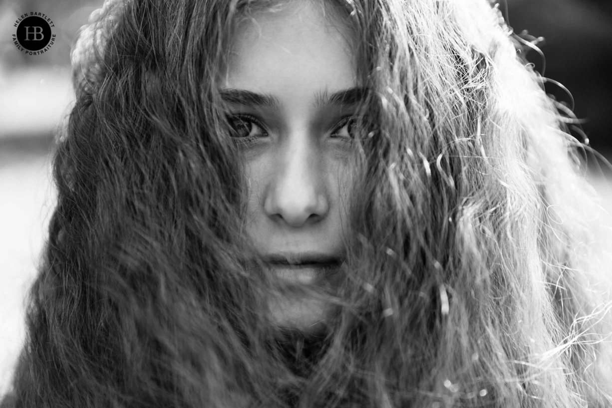 teenager portrait with amazing hair and striking eyes