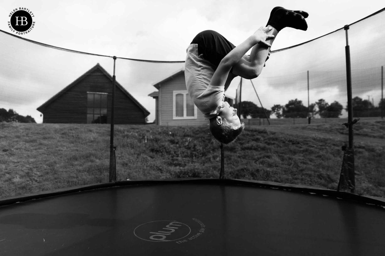 boy plays on trampoline at gladwins farm in suffolk