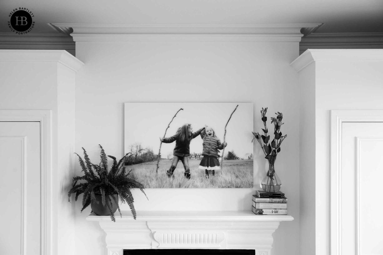 large acrylic print hung above fireplace