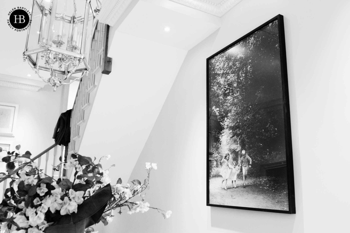very large framed family portrait in London townhouse