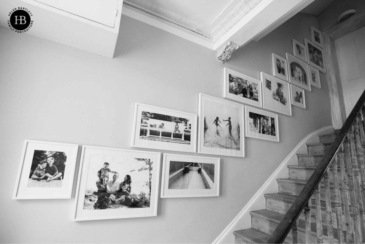 stairway gallery of framed fine art family photographs